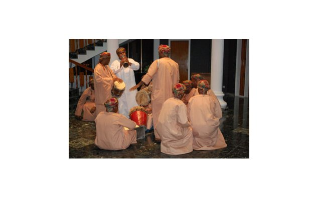 Performance of an Omani traditional musical band after the conference in the Cultural Club's hall.